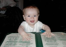 Thomas Edward Glass studies the menu at Galway Bay Irish Pub, one of Hannah' favorite Annapolis hangouts.